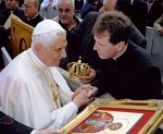 Fr John presents a copy of the St Genesius Icon to the Pope, Click to find out more.